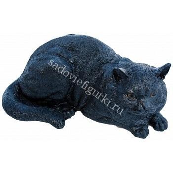 Кошка лежит чёрная